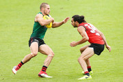 David Zaharakis runs past Jake Long during an Essendon Bombers AFL training session at The Hangar on March 20, 2018 in Melbourne, Australia.