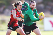 Jake Stringer of Essendon, tipped to be an inclusion for this weekend, runs with the ball from Jake Long during an Essendon Bombers AFL training session at The Hangar on July 24, 2018 in Melbourne, Australia.
