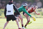 Jake Long (R) competes for the ball against  Andrew MGrath during an Essendon Bombers AFL training session at The Hangar on July 24, 2018 in Melbourne, Australia.
