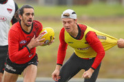Jake Long of the Bombers runs with the ball during an Essendon Bombers AFL training session at The Hangar on May 16, 2018 in Melbourne, Australia.