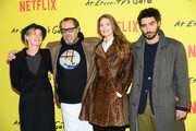 """Anne Consigny, .Julian Schnabel, Louise Kugelberg, Vladimir Consigny attend the Photocall for """"At Eternity's Gate"""" film at Musee du Louvre on April 02, 2019 in Paris, France."""