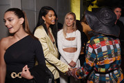 Chanel Iman (2L) greets Halima Aden (R) at the Etihad Airways cocktail party during NYFW: The Shows at Spring Studios on September 10, 2019 in New York City.