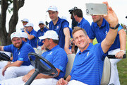 Ian Poulter takes a selfie with  Ross Fisher, Lee Westwood and Bernd Wiesberger of team Europe look on during the final day's singles matches at the EurAsia Cup presented by DRB-HICOM at Glenmarie G&CC on January 17, 2016 in Kuala Lumpur, Malaysia..
