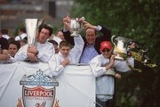 20 May 2001:  Robbie Fowler, Steven Gerrard, manager Gerard Houllier and Sami Hyypia display Liverpool's three trophies, the UEFA Cup, Worthington Cup and FA Cup, on a parade through the streets of Liverpool.  Mandatory Credit: Clive Brunskill /Allsport