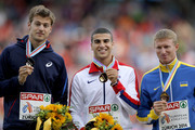 (L-R) Silver medalist Christophe Lemaitre of France, gold medalist Adam Gemili of Great Britain and Northern Ireland and Serhiy Smelyk of Ukraine celebrate on the podium during the medal ceremony for the Men's 200 metres final during day five of the 22nd European Athletics Championships at Stadium Letzigrund on August 16, 2014 in Zurich, Switzerland.