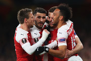 Aaron Ramsey of Arsenal celebrates scoring his teams first goal of the game with team mates Nacho Monreal, Sead Kolasinac and Pierre-Emerick Aubameyang during the UEFA Europa League Quarter Final First Leg match between Arsenal and S.S.C. Napoli at Emirates Stadium on April 11, 2019 in London, England.