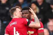 Paul Pogba of Manchester United celebrates with teammate Phil Jones after scoring his team's first goal during the Premier League match between Fulham FC and Manchester United at Craven Cottage on February 9, 2019 in London, United Kingdom.