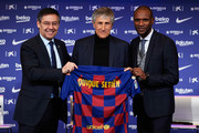 FC Barcelona President Josep Maria Bartomeu, Head Coach Quique Setien and Sporting Director Eric Abidal pose for the media as Quique Setien is unveiled as new FC Barcelona Coach at Camp Nou on January 14, 2020 in Barcelona, Spain.
