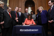 U.S. Speaker of the House Nancy Pelosi (D-CA) (C) signs the articles of impeachment against President Donald Trump during an engrossment ceremony with Rep. Carolyn Maloney (D-NY), Rep. Jerrold Nadler (D-NY), Rep. Eliot Engle (D-NY), Rep. Adam Schiff (D-CA), Rep. Richard Neal (D-MA), Rep. Maxine Waters (D-CA), Rep. Val Demings (D-FL), Rep. Zoe Lofgren (D-CA) and Rep. Jason Crow (D-CO) in the Rayburn Room at the U.S. Capitol January 15, 2020 in Washington, DC. The House of Representatives voted to approve the managers and send the articles of impeachment to the Senate, where Majority Leader Mitch McConnell (R-KY) said the trial will begin next Tuesday.