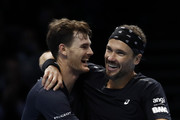Jamie Murray of Great Britain and Bruno Soares of South Africa celebrate during their match against Michael Venus of New Zealand and Raven Klaasen of South Africa  during Day One of the Nitto ATP World Tour Finals at The O2 Arena on November 11, 2018 in London, England.