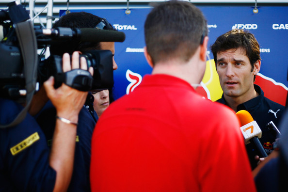 Mark Webber of Australia and Red Bull Racing is interviewed in the paddock during previews to the European Formula One Grand Prix at the Valencia Street Circuit on July 24, 2010, in Valencia, Spain.