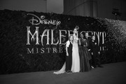 """Image has been converted to black and white)  (L-R) Vivienne Marcheline Jolie-Pitt, Angelina Jolie, Zahara Marley Jolie-Pitt, Shiloh Nouvel Jolie-Pitt and Knox Jolie-Pitt attend the European Premiere of Disney's """"Maleficent: Mistress of Evil"""" at Odeon IMAX Waterloo on October 09, 2019 in London, England."""
