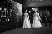 """Image has been converted to black and white)  Elle Fanning (R) and Angelina Jolie attend the European Premiere of Disney's """"Maleficent: Mistress of Evil"""" at Odeon IMAX Waterloo on October 09, 2019 in London, England."""