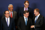 (top L-R)  Prime Minister of Portugal, Antonio Costa and Prime minister of Finland, Juha Sipila and (Bottom L-R) President of France, Francois Hollande, Turkish Prime Minister Ahmet Davutoglu and European council president, Donald Tusk are pictured during the family photo call at The European Council Meeting In Brussels held at the Justus Lipsius Building on March 7, 2016 in Brussels, Belgium.  EU leaders are meeting with Turkish Prime Minister Ahmet Davutoglu in Brussels, to discuss the worst refugee crisis since the Second World War, as thousands of migrants remain stranded in Greece after borders along the Balkan route to Germany are closed.
