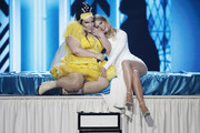 Netta Barzilai and Bar Refaeli on stage during the 64th annual Eurovision Song Contest held at Tel Aviv Fairgrounds on May 18, 2019 in Tel Aviv, Israel.
