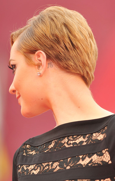 "Evan Rachel Wood Actress Evan Rachel Wood (tatoo/earring detail) attends the ""Mildred Pierce"" premiere during the 68th Venice Film Festival at Palazzo del Cinema on September 2, 2011 in Venice, Italy."