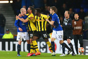 Steven Naismith of Everton (L) is held back by Raphael Nuzzolo of BSC Young Boys (2L) as he clashes with Sekou Sanogo Junior (2R) of BSC Young Boys, who is held back by Seamus Coleman of Everton (R) during the UEFA Europa League Round of 32 match between Everton FC and BSC Young Boys at Goodison Park on February 26, 2015 in Liverpool, United Kingdom.
