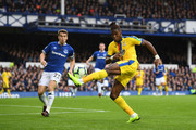Wilfried Zaha of Crystal Palace in action as Seamus Coleman of Everton looks on during the Premier League match between Everton FC and Crystal Palace at Goodison Park on October 21, 2018 in Liverpool, United Kingdom.