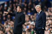 Roy Hodgson, Manager of Crystal Palace looks on as Marco Silva, Manager of Everton reacts during the Premier League match between Everton FC and Crystal Palace at Goodison Park on October 21, 2018 in Liverpool, United Kingdom.