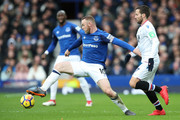 Wayne Rooney of Everton is challenged by Yohan Cabaye of Crystal Palace during the Premier League match between Everton and Crystal Palace at Goodison Park on February 10, 2018 in Liverpool, England.