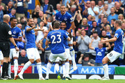 Theo Walcott of Everton celebrates scoring his team's first goal with team mates during the Premier League match between Everton FC and Southampton FC at Goodison Park on August 18, 2018 in Liverpool, United Kingdom.