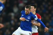 Gylfi Sigurdsson of Everton is tackled by Gareth Barry of West Bromwich Albion during the Premier League match between Everton and West Bromwich Albion at Goodison Park on January 20, 2018 in Liverpool, England.
