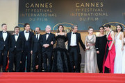 """(L-R) Producer Alexandre Mallet-Guy, actors Eduard Fernandez, Javier Bardem, director Asghar Farhadi, Cannes Film Festival Director Thierry Fremaux, actress Penelope Cruz, wearing jewels by Atelier Swarovski Fine Jewelry, actor Ricardo Darin, actress Carla Campra, actress Elvira Minguez, Barbara Lennie, actress Sara Salamo and Inma Cuesta attend the screening of """"Everybody Knows (Todos Lo Saben)"""" and the opening gala during the 71st annual Cannes Film Festival at Palais des Festivals on May 8, 2018 in Cannes, France."""