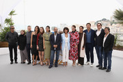 """(L-R) Actor Ricardo Darin, Guests, (4th-L-R) actress Penelope Cruz, wearing jewels by Atelier Swarovski Fine Jewelry, Carla Campra, Sara Salamo, director Asghar Farhadi, guest, Barbara Lennie, Elvira Minguez, actor Javier Bardem, Producer Alvaro Longoria and Eduard Fernandez attend the photocall for """"Everybody Knows (Todos Lo Saben)"""" during the 71st annual Cannes Film Festival at Palais des Festivals on May 9, 2018 in Cannes, France."""