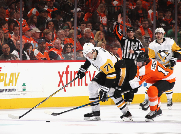 Pittsburgh Penguins vs. Philadelphia Flyers - Game Three [game three,player,college ice hockey,ice hockey,sports,hockey protective equipment,sports gear,ice hockey position,team sport,ice hockey equipment,defenseman,evgeni malkin,sean couturier,puck,philadelphia,philadelphia flyers,pittsburgh penguins,nhl,eastern conference,round]