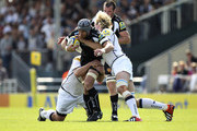 Craig Mitchell of Exeter is tackled by Andy Powell of Sale during the Aviva Premiership match between Exeter Chiefs and Sale Sharks at the Sandy Park Stadium on September 1, 2012 in Exeter, England.
