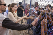 United Nations High Commissioner for Refugees (UNCHR) Special Envoy Angelina Jolie greets people during her visit to a refugee camp in the border between Colombia and Venezuela on June 8, 2019 in Maicao, Colombia. UN and International Organization for Migration (IOM) announced yesterday that 4 million of Venezuelans have left their country since 2015 due to the social, political and economic crisis, which means they are of the single largest population groups displaced from their country globally. The camp in Maicao has 60 tents  which can accommodate up to 350 people. Due to high demand, UNHCR is considering an expansion to give shelter to 1,400 people. Colombia it the top host of Venezuelan migrants and refugees, accounting 1.3 million.
