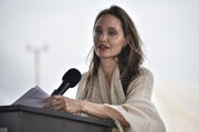 United Nations High Commissioner for Refugees (UNCHR) Special Envoy Angelina Jolie delivers a speech during a press conference after visiting a refugee camp in the border between Colombia and Venezuela on June 8, 2019 in Maicao, Colombia. UN and International Organization for Migration (IOM) announced yesterday that 4 million of Venezuelans have left their country since 2015 due to the social, political and economic crisis, which means they are of the single largest population groups displaced from their country globally. The camp in Maicao has 60 tents  which can accommodate up to 350 people. Due to high demand, UNHCR is considering an expansion to give shelter to 1,400 people. Colombia it the top host of Venezuelan migrants and refugees, accounting 1.3 million.