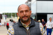 Former F1 team principal Colin Kolles walks through the paddock during previews ahead of the British Formula One Grand Prix at Silverstone Circuit on July 3, 2014 in Northampton, United Kingdom.