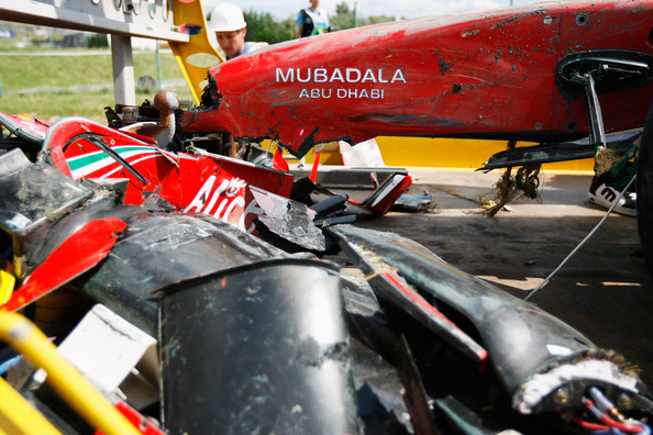 The car of Felipe Massa of Brazil and Ferrari is taken away on a flatbed truck following his accident during qualifying for the Hungarian Formula One Grand Prix at the Hungaroring on July 25, 2009 in Budapest, Hungary.
