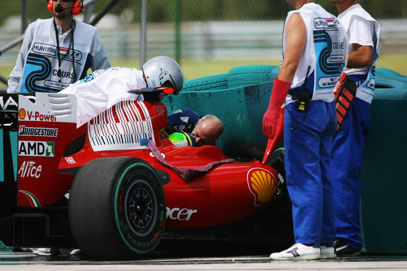Felipe Massa of Brazil and Ferrari is attended to by Gary Hartstein, medical staff and marshalls following his accident during qualifying for the Hungarian Formula One Grand Prix at the Hungaroring on July 25, 2009 in Budapest, Hungary.