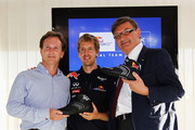Sebastian Vettel (C) of Germany and Red Bull Racing is seen with his Team Principal Christian Horner (L) and GEOX Chairman Mario Moretti Polegato (R) at a press conference during previews to the Italian Formula One Grand Prix at the Autodromo Nazionale di Monza on September 8, 2011 in Monza, Italy.