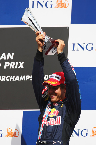 Third placed Sebastian Vettel of Germany and Red Bull Racing celebrates on the podium following the Belgian Grand Prix at the Circuit of Spa Francorchamps on August 30, 2009 in Spa Francorchamps, Belgium.