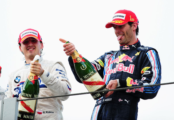 Mark Webber of Australia and Red Bull Racing celebrates on the podium after winning the Brazilian Formula One Grand Prix at the Interlagos Circuit on October 18, 2009 in Sao Paulo, Brazil.