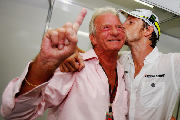 Jenson Button (R) of Great Britain and Brawn GP celebrates with his father John Button (L) after clinching the F1 World Drivers Championship during the Brazilian Formula One Grand Prix at the Interlagos Circuit on October 18, 2009 in Sao Paulo, Brazil.