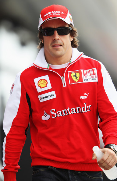 Fernando Alonso of Spain and Ferrari walks in the paddock before the Chinese Formula One Grand Prix at the Shanghai International Circuit on April 18, 2010 in Shanghai, China.