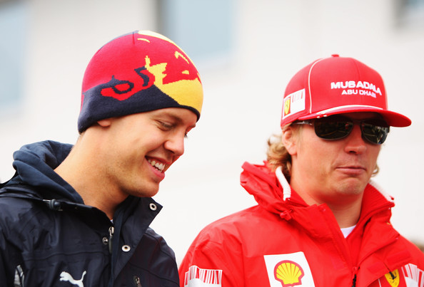 Sebastian Vettel (L) of Germany and Red Bull Racing and Kimi Raikkonen (R) of Finland and Ferrari are seen in the paddock before the German Formula One Grand Prix at Nurburgring on July 12, 2009 in Nurburg, Germany.