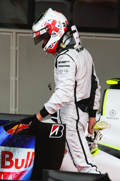 Jenson Button of Great Britain and Brawn GP walks back to his garage following the British Formula One Grand Prix at Silverstone on June 21, 2009 in Northampton, England.