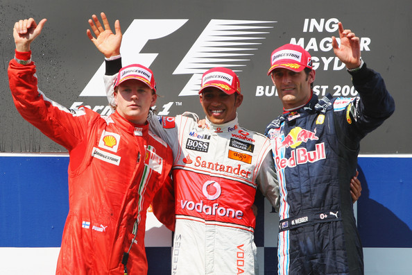 First placed Lewis Hamilton (C) of Great Britain and McLaren Mercedes celebrates on the podium with second placed Kimi Raikkonen (L) of Finland and Ferrari and third placed Mark Webber of Australia and Red Bull Racing following the Hungarian Formula One Grand Prix at the Hungaroring on July 26, 2009 in Budapest, Hungary.