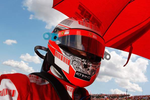 Kimi Raikkonen of Finland and Ferrari is seen on the grid as he prepares to drive during the Hungarian Formula One Grand Prix at the Hungaroring on July 26, 2009 in Budapest, Hungary.