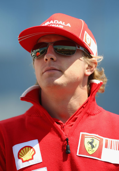 Kimi Raikkonen of Finland and Ferrari attends the drivers parade during the Hungarian Formula One Grand Prix at the Hungaroring on July 26, 2009 in Budapest, Hungary.