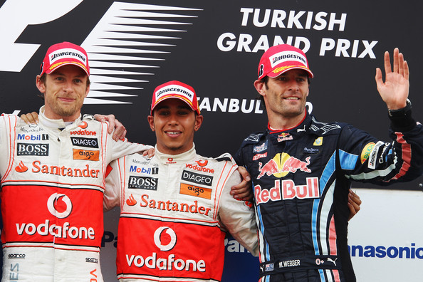 Race winner Lewis Hamilton (C) of Great Britain and McLaren Mercedes celebrates with second placed team mate Jenson Button (L) of Great Britain and McLaren Mercedes and third placed Mark Webber (R) of Australia and Red Bull Racing on the podium after the Turkish Formula One Grand Prix at Istanbul Park on May 30, 2010, in Istanbul, Turkey.