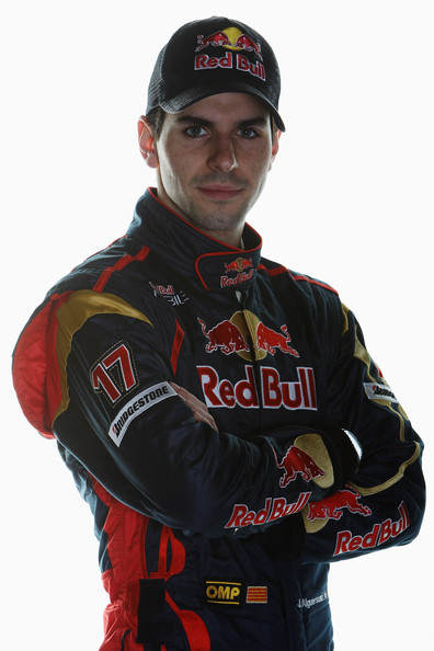 Jaime Alguersuari of Spain and Scuderia Toro Rosso poses for a photograph during Formula One winter testing at the Circuit De Catalunya on February 26, 2010 in Barcelona, Spain.