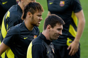 Neymar JR. (L) of FC Barcelona  and his teammate Lionel Messi (L) walks on during the training session the day before the UEFA Champions League Quarter-final match between Atletico de Madrid and FC Barcelona at Vicente Calderon Stadium on April 8, 2014 in Madrid, Spain.