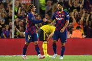 Antoine Griezmann and Luis Suarez of Barcelona celebrate as Ainsley Maitland-Niles of Arsenal scores an own goal for their first goal during the Joan Gamper Trophy pre-season friendly match between FC Barcelona and Arsenal at Nou Camp on August 04, 2019 in Barcelona, Spain.