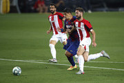 Luis Suarez of Barcelona is tackled  during the Liga match between FC Barcelona and Athletic Club at Camp Nou on June 23, 2020 in Barcelona, Spain. Football Stadiums around Europe remain empty due to the Coronavirus Pandemic as Government social distancing laws prohibit fans inside venues resulting in all fixtures being played behind closed doors.